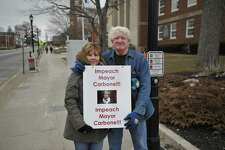 Raymond and Carol Bottass spent a portion of Wednesday afternoon protesting the recent decision to approve a sewer pipeline between the Woodridge Lake housing development and the Torrington system.
