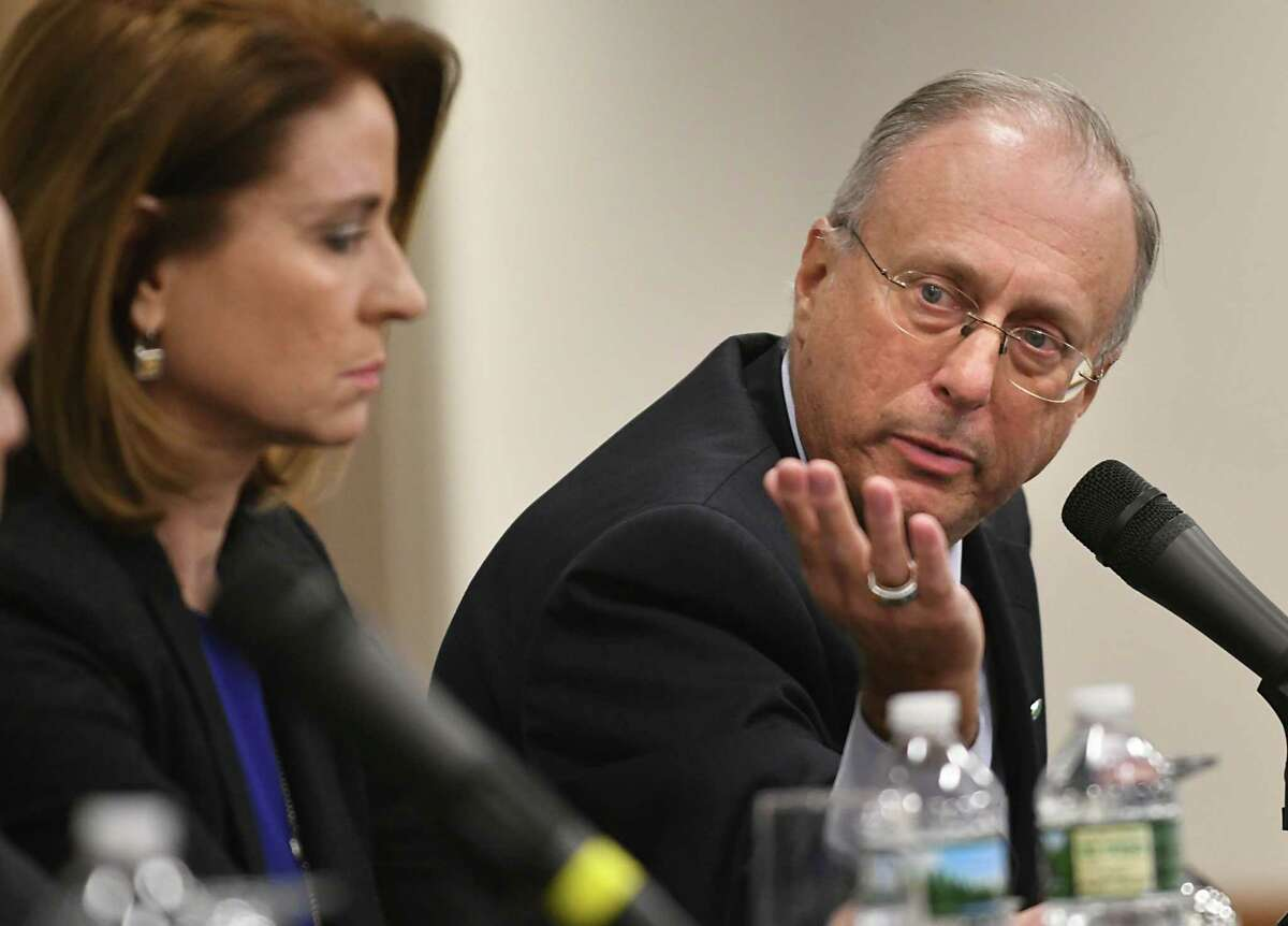 John Bennett of CDPHP speaks on a panel of local health care executives who discussed the prospects for disruption in the health care industry at the Hearst Media Center on Tuesday, March 20, 2018 in Colonie, N.Y. Joan Regan Hayner of Community Care Physicians, P.C. listens at left. (Lori Van Buren/Times Union)