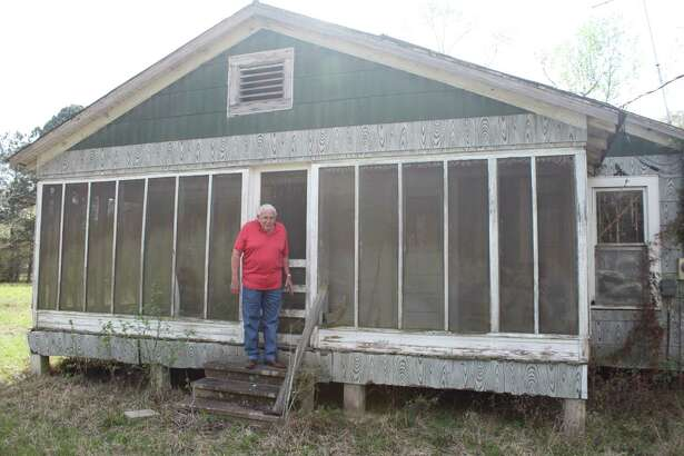 Larry Litton stands outside a 'time capsule home' he recently purchased in the Cleveland area.