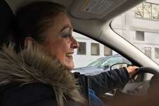 Neighborhood Specialist Carmen Mendez drives through Wooster Square looking for quality of life issues.