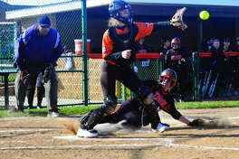 Edwardsville senior Anna Burke, bottom, slides in safely to home plate during the first inning against Gillespie on Wednesday inside the District 7 Sports Complex.