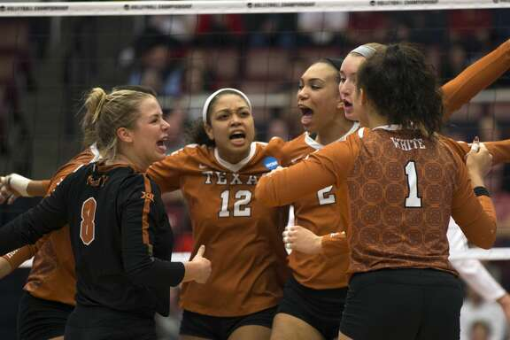 Texas players exult after getting off to a fast start against Stanford during the first set of an NCAA women's volleyball regional match on Saturday, Dec. 9, 2017 in Stanford, Calif.. Stanford won in straight sets.