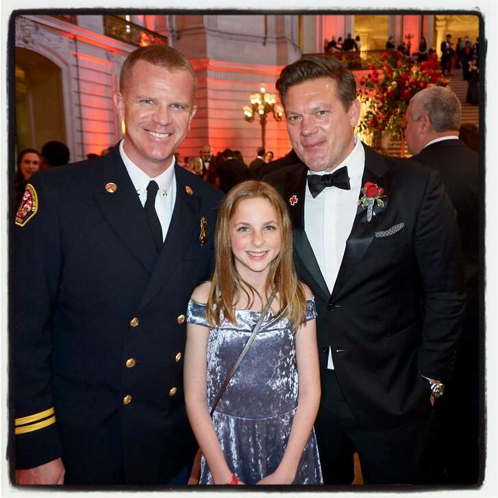 Santa Rosa Fire Dept. Battalion Chief Scott Westrope (left) with his daughter Abby and Chef Tyler Florence at City Hall for the Red Cross Gala. March 17, 2018.