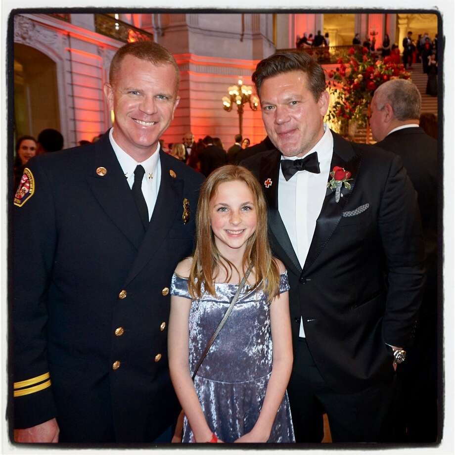 Santa Rosa Fire Dept. Battalion Chief Scott Westrope (left) with his daughter Abby and Chef Tyler Florence at City Hall for the Red Cross Gala. March 17, 2018. Photo: Catherine Bigelow / Special To The Chronicle