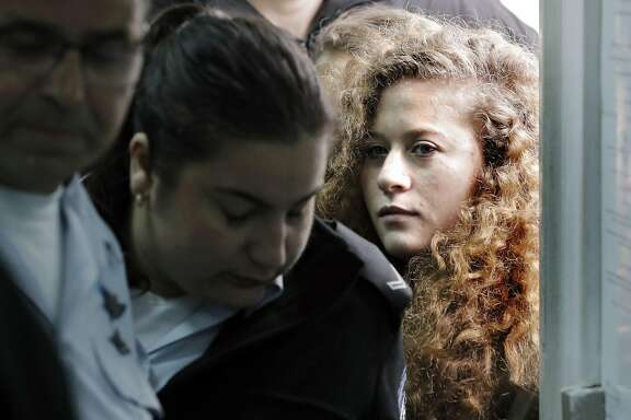 (FILES) In this file photo taken on February 13, 2018, seventeen-year-old Palestinian Ahed Tamimi (R), a well-known campaigner against Israel's occupation, arrives for the beginning of her trial in the Israeli military court at Ofer military prison in the West Bank village of Betunia.  Tamimi who was arrested after a viral video showed her hitting two Israeli soldiers in the occupied West Bank has reached a plea deal with prosecutors to serve eight months in jail, Human Rights Watch said on March 21, 2018. / AFP PHOTO / THOMAS COEXTHOMAS COEX/AFP/Getty Images