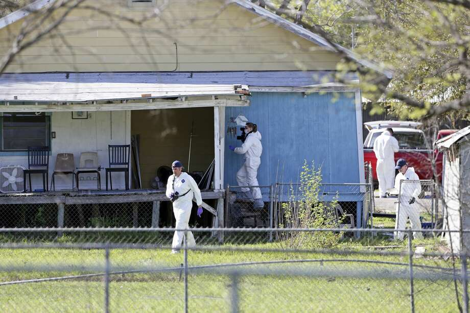 Crime scene photographers work through the backyard at the scene of Walnut and 2nd Street in Pflugerville where bombing suspect lived  on March 21, 2018. Photo: Tom Reel/San Antonio Express-News