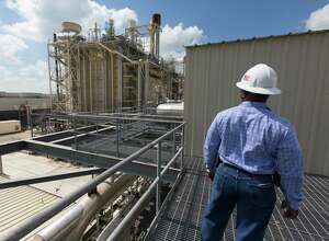 In this 2017 photo, a worker looks over CPS Energy's natural gas-fired Rio Nogales power plant. This reflects industry trends — and is good for Texas and the environment.