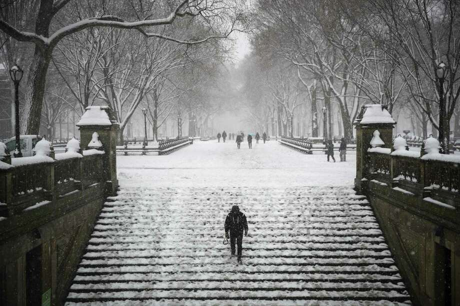 NEW YORK, NY - MARCH 21: A man walks down steps toward the Bethesda Fountain and Terrace in Central Park during a snowstorm, March 21, 2018 in New York City. The fourth nor'easter in three weeks hit the city on Wednesday, bringing wind and accumulating snow. (Photo by Drew Angerer/Getty Images) *** BESTPIX *** Photo: Drew Angerer / 2018 Getty Images