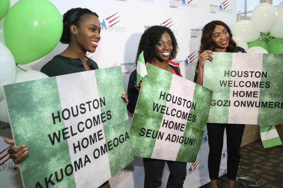 The 2018 Winter Olympic Games Women's Nigerian Bobsled Team Members Akuoma Omeoga, from left, Seun Adigun and Ngozi Onwumere, pose for photographs after sharing their bobsledding stories at the University of Houston Alumni Center on Wednesday, March 21, 2018, in Houston. They were not just the first Nigerian olympic bobsled team but the first-ever African olympic bobsled team. Adigun and Onwumere graduated from the UH track team. ( Yi-Chin Lee / Houston Chronicle ) Photo: Yi-Chin Lee / Houston Chronicle / © 2018 Houston Chronicle