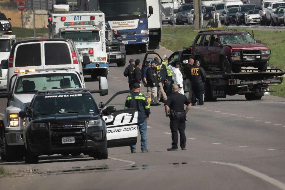The vehicle that the Austin package bomber, Mark Anthony Conditt, was driving when he blew himself up is towed from the crime scene along Interstate 35 in Round Rock on Wednesday. Photo: Scott Olson /Getty Images / 2018 Getty Images