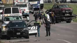 The vehicle that the Austin package bomber, Mark Anthony Conditt, was driving when he blew himself up is towed from the crime scene along Interstate 35 in Round Rock on Wednesday.