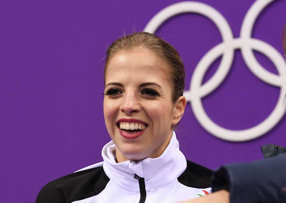 Italy's Carolina Kostner smiles after the women's single skating free skating of the figure skating event during the Pyeongchang 2018 Winter Olympic Games at the Gangneung Ice Arena in Gangneung on February 23, 2018. / AFP PHOTO / Roberto SCHMIDTROBERTO SCHMIDT/AFP/Getty Images Photo: ROBERTO SCHMIDT / AFP