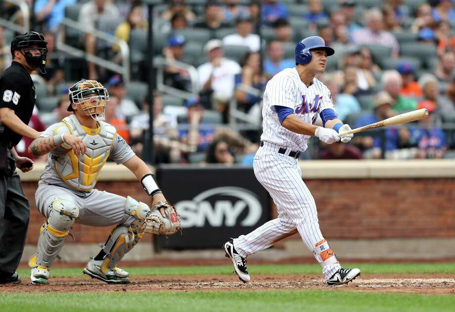 NEW YORK, NY - JULY 23:  Michael Conforto #30 of the New York Mets hits a solo home run in the third inning as Bruce Maxwell #13 of the Oakland Athletics defends in the third inning on July 23, 2017 at Citi Field in the Flushing neighborhood of the Queens borough of New York City.  (Photo by Elsa/Getty Images) ORG XMIT: 700011721 Photo: Elsa / 2017 Getty Images