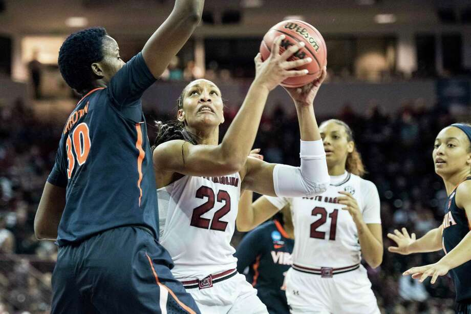 FILE - In this Sunday, March 18, 2018, file photo, South Carolina forward A'ja Wilson (22) drives to the hoop against Virginia center Felicia Aiyeotan (30) during the first half of a second-round game at the NCAA women's college basketball tournament in Columbia, S.C.    Even as basketball has gone away from tradition position players trending towards more versatile talents, there is a plethora of dominant post players like Teaira McCowan, Azura Stevens, A'ja Wilson and Kalani Brown leaving their mark in the women's NCAA Tournament. (AP Photo/Sean Rayford, File) Photo: Sean Rayford / The Associated Press