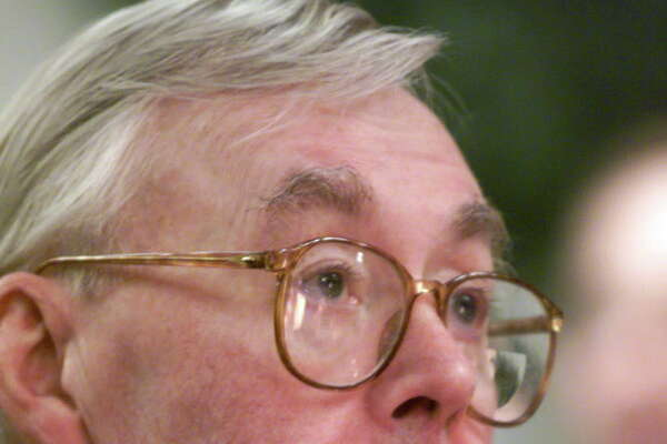 ** FILE ** New York Senator Daniel Patrick Moynihan listens to a speech at New Yorks Fordham University, in this Dec. 14, 1999 file photo. Moynihan, a New York City shoe shine boy who became an iconoclastic scholar-politician and served four terms in the Senate, died Wednesday, March 26, 2003. He was 76. (AP Photo/Richard Drew, File)