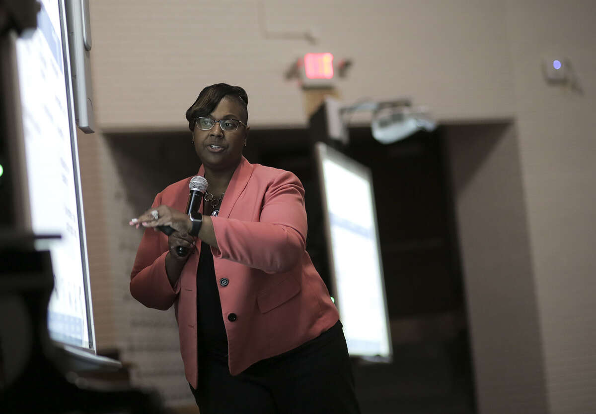 Chief Academic Officer Grenita Lathan points to a slide during a community meeting at Worthing High School as part of a series of meetings HISD held ahead of next month's planned vote to hand over control of several schools on Wednesday, March 21, 2018, in Houston. (Elizabeth Conley / Houston Chronicle)