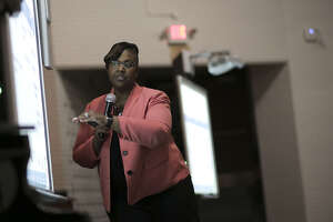Chief Academic Officer Grenita Lathan points to a slide during a community meeting at Worthing High School as part of a series of meetings HISD held ahead of next month's planned vote to hand over control of several schools on Wednesday, March 21, 2018, in Houston. (Elizabeth Conley / Houston Chronicle )