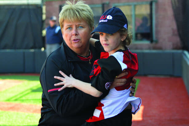 Karlie Maine, a 7-year-old from Alhambra, got to celebrate her birthday on Wednesday with the SIUE softball team, including Cougars coach Sandy Montgomery.
