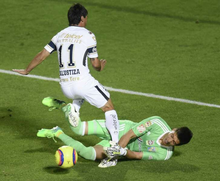 Matías Alustiza of the Pumas UNAM has his shot  blocked by Tigres UANL goalie Eduardo Fernandez during a Liga MX exhibition game at Toyota Field on Wednesday night, March 21, 2018.