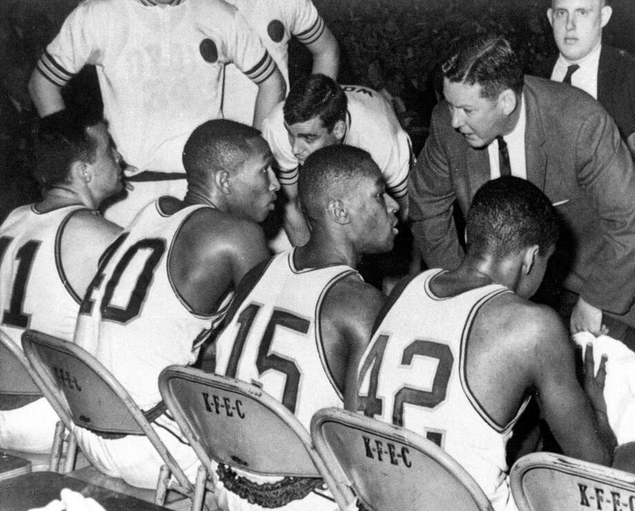 In this March 23, 1963, file photo, Loyola coach George Ireland, right