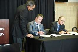 From left, Laredo Energy Arena general manager Xavier Villalon, USACHL co-owner Bill Davidson and commissioner Rick Kozuback signed a lease Wednesday at a press conference announcing the return of hockey to Laredo.