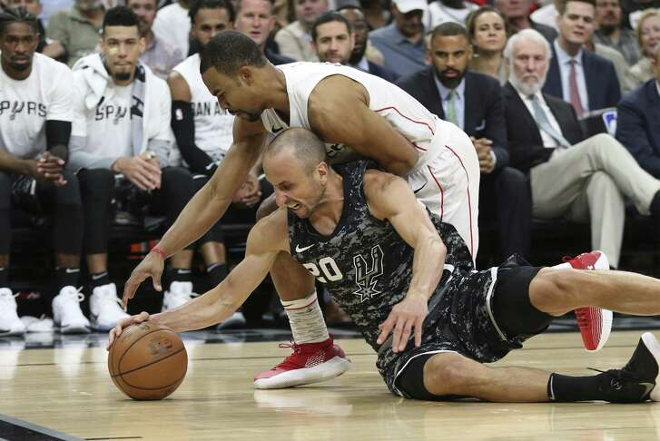 Spurs' Manu Ginobili (20) fights for a loose ball against Washington Wizards' Ramon Sessions (09) at the AT&T Center on Wednesday, Mar. 21, 2018. (Kin Man Hui/San Antonio Express-News)