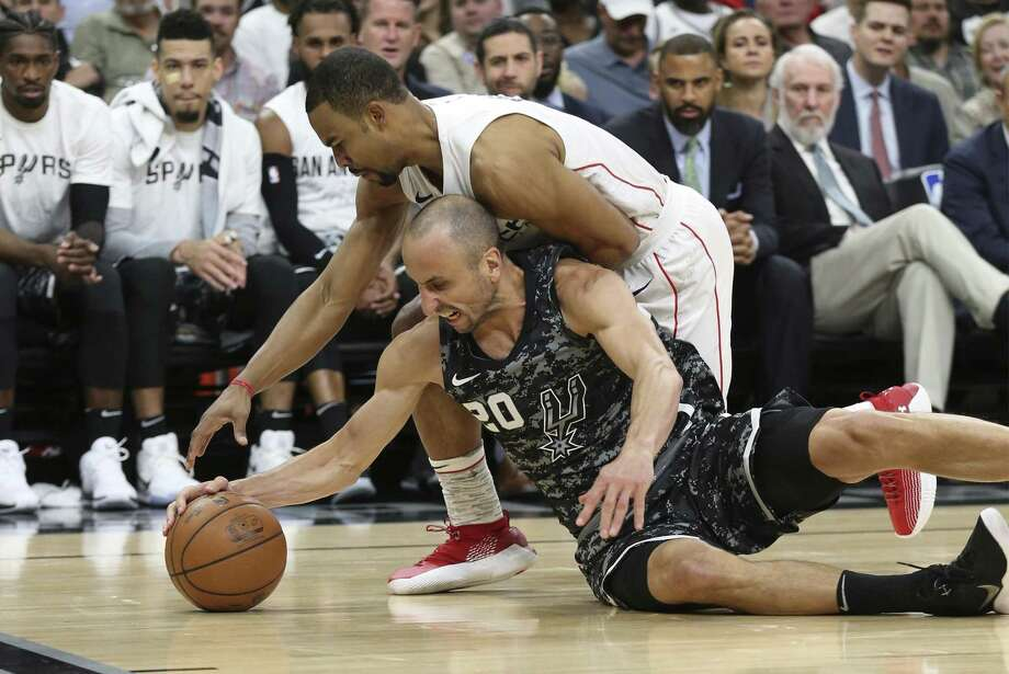 Spurs' Manu Ginobili (20) fights for a loose ball against Washington Wizards' Ramon Sessions (09) at the AT&T Center on Wednesday, Mar. 21, 2018. (Kin Man Hui/San Antonio Express-News) Photo: Kin Man Hui, Staff / San Antonio Express-News / ©2018 San Antonio Express-News