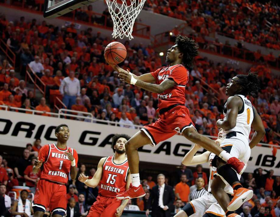 Western Kentucky's Taveion Hollingsworth (13) goes to the basket past Oklahoma State's Kendall Smith (1) during an NCAA college basketball game in the NIT quarterfinals, in Stillwater, Okla., Wednesday, March 21, 2018. (Bryan Terry/The Oklahoman via AP) Photo: Bryan Terry / BRYAN TERRY/THE OKLAHOMAN