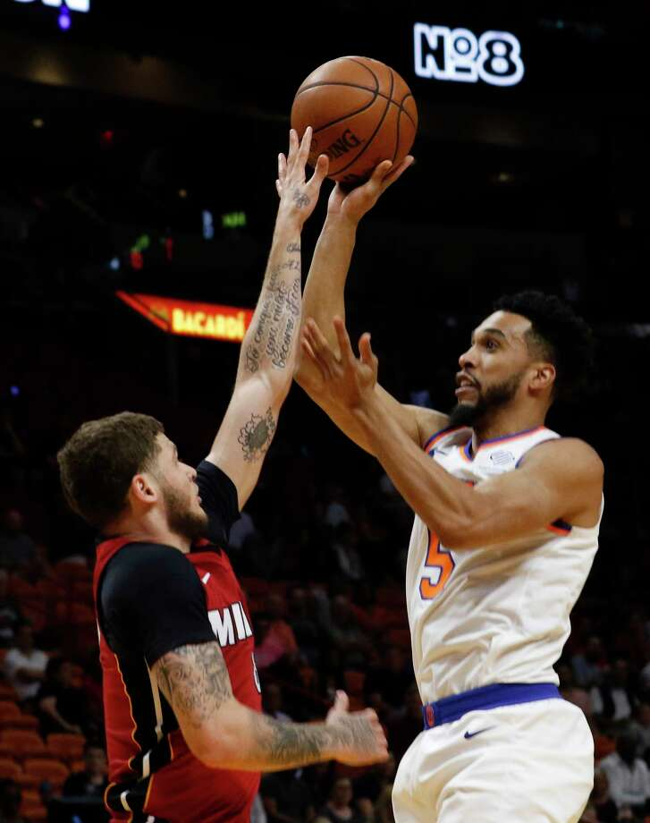 New York Knicks guard Courtney Lee (5) shoots over Miami Heat guard Tyler Johnson during the first quarter of an NBA basketball game Wednesday, March 21, 2018, in Miami. (AP Photo/Joe Skipper) Photo: Joe Skipper / FR171174 AP