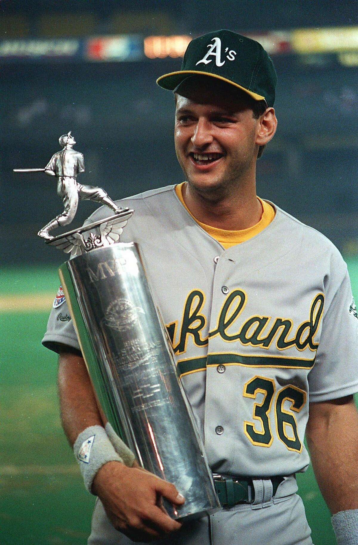In this file photo Oakland A's Terry Steinbach holds his Most Valuable Player trophy after being selected as the top player in the All-Star game in Cincinnati, in this July 13, 1988 photo. Minnesota Twins catcher Terry Steinbach announced Tuesday Nov. 16, 1999 he is retiring from baseball after 13 full seasons, three with Minnesota. Steinbach, 37, signed with the Twins as a free agent in 1996 after 11 years with Oakland. (AP Photo/Al Behrman)****FILE PHOTO