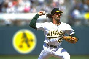 25 JUL 1992: FILE PICTURE: OAKLAND A'S PITCHER DENNIS ECKERSLEY WINDS UP TO PITCH DURING THE A'S VERSUS MINNESOTA TWINS GAME AT OAKLAND COUNTY STADIUM IN OAKLAND, CALIFORNIA. ECKERSLEY RESIGNED WITH THE A'S ON 2 APR 1995. MANDATORY CREDIT: OTTO GREULE/ALLSPORT USA ALSO RAN: 2/14/96