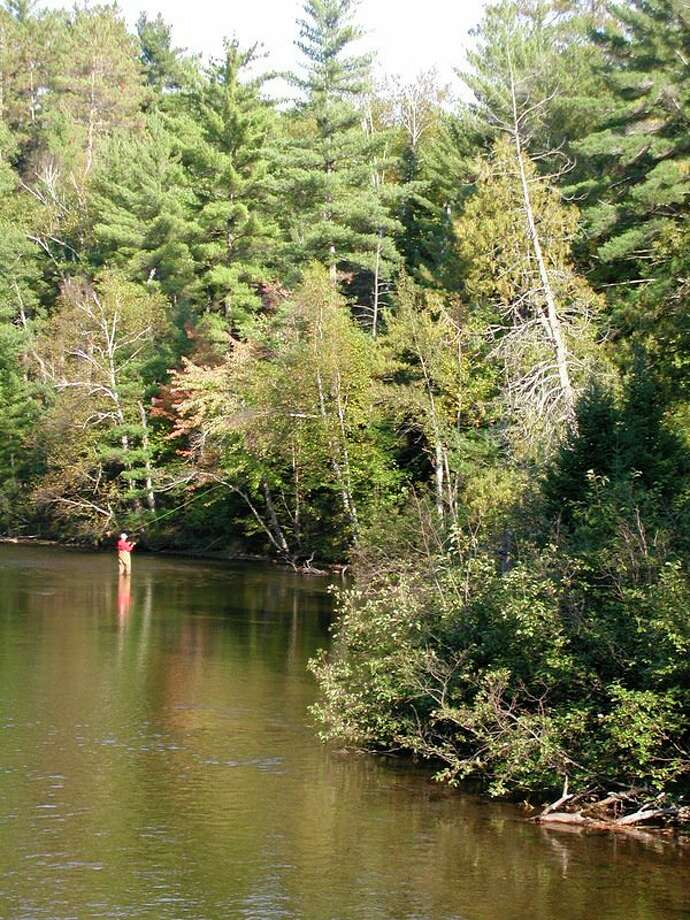 Michigan inland stream trout anglers placed the highest priority on beautiful surroundings -- as in this file photo of AuSable River river fly fishing -- in a recent DNR survey, a report on which was issued recently. (Steve Griffin/Hearst Michigan)