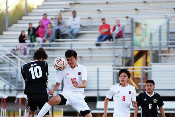 The Panthers senior MF Eduardo Diaz mixes it up mid-air with the Falcons Oscar Botello in their district title contest last Tuesday night at Falcon Stadium in Huffman.