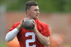 FILE - In this May 26, 2015, file photo, Cleveland Browns quarterback Johnny Manziel looks to pass during an NFL organized training activity in Berea, Ohio. Browns coach Mike Pettine said Monday, July 27, 2015, that veteran Josh McCown will open training camp as the teamâ??s No. 1 quarterback, but that Manziel, the former Heisman Trophy winner who had a disastrous rookie season, still has a chance to win the job based on his performance. (AP Photo/David Richard, File)
