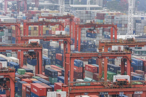Shipping containers sit stacked among remote-controlled gantry cranes at Kwai Tsing Container Terminals in Hong Kong on Jan. 30, 2018.