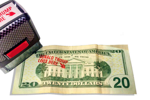 """Trump supporters have a new way to boast about their president by stamping """"Donald Trump lives here"""" to put over the White House on $20 bills.  Source:  Americanaf.com"""