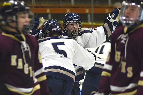 Ryan Purgay of Staples embraces teammate Casten Ernberg after the Wreckers scored the first goal of the game during last Thursday night's Division III hockey semifinals.