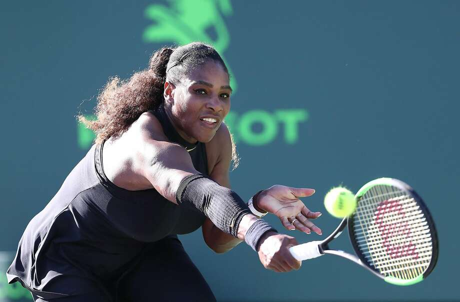 Serena Williams returns a shot against Naomi Osaka of Japan during Day 3 of the Miami Open at the Crandon Park Tennis Center on March 19, 2018 in Key Biscayne, Florida. Photo: Al Bello, Getty Images