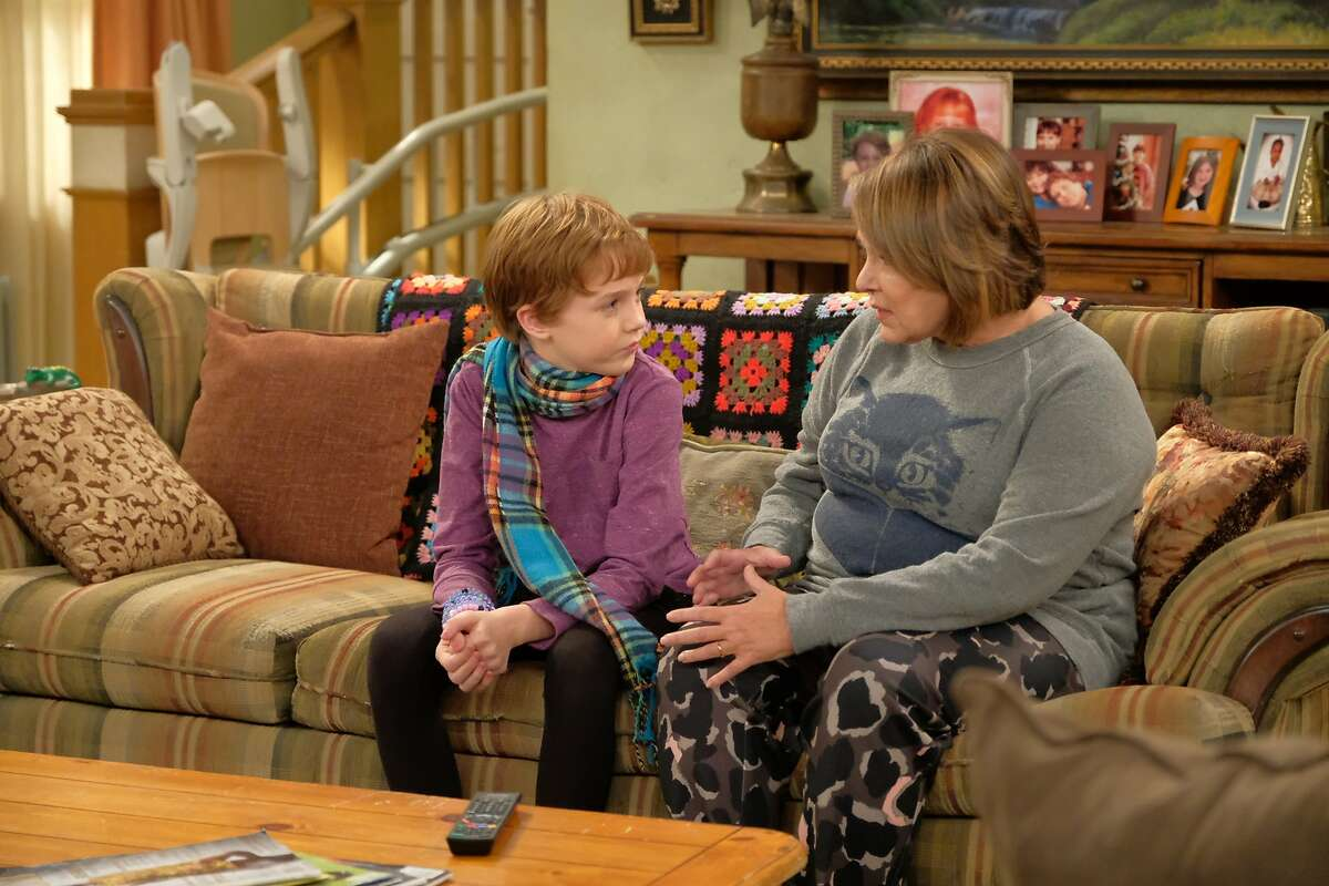 """Roseanne (Roseanne Barr) shares a warm moment with her grandson (Ames McNamara), who tells her how important it is to him to dress the way he wants, including wearing a skirt and colors """"that pop,"""" even if he faces possible bullying at school in the revival of """"Roseanne"""" on ABC."""