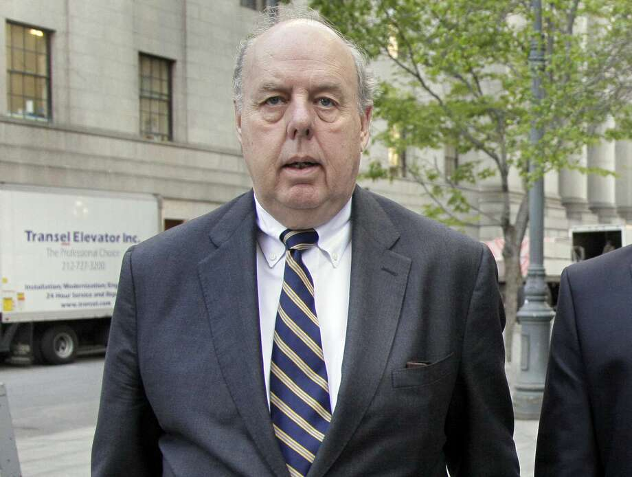 FILE - In this April 29, 20111, file photo, Attorney John Dowd walks in New York. Down, one of the key lawyers in President Donald Trump's corner navigated a popular United States senator through crisis, produced a damning investigative report that drove a baseball star from the game and, early in his career, took on organized crime as a Justice Department prosecutor. Dowd assumed a more prominent place on the legal team after another lawyer, Marc Kasowitz, took a reduced role.  (AP Photo/Richard Drew, File) Photo: Richard Drew/AP