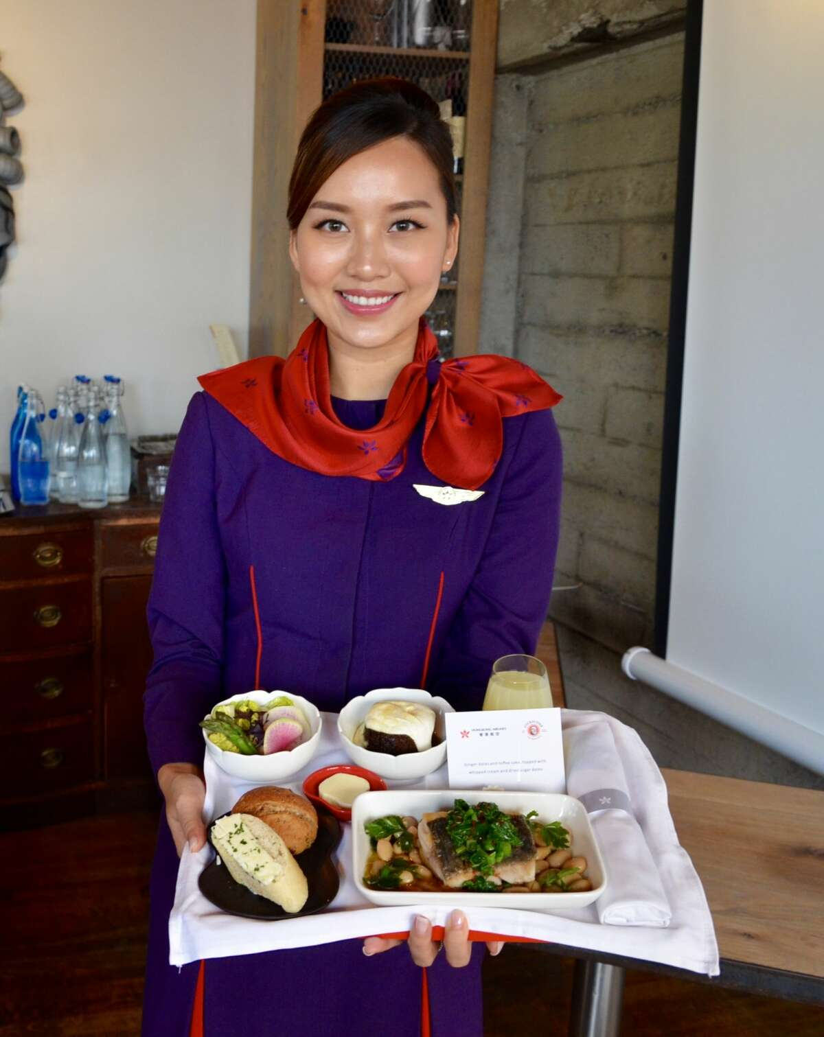 Flight attendants help introduce new business class meals at Cockscomb restaurant in San Francisco