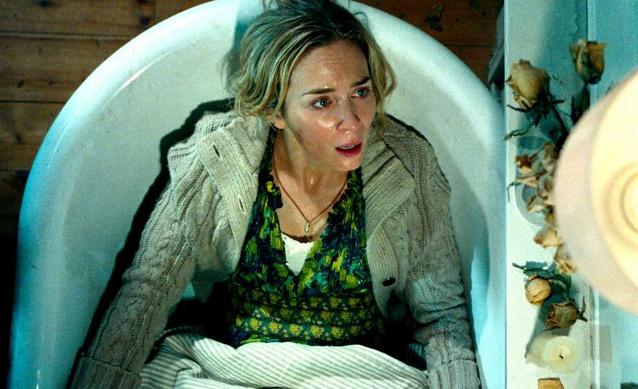 """Need combo cap: Above: Emily Blunt in """"A Quiet Place."""" At right: Blunt with co-star John Krasinski, who is her husband and also directed the film. Photo: Paramount"""
