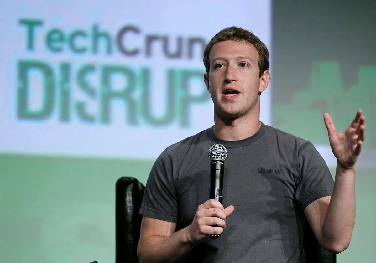 """Facebook CEO Mark Zuckerberg speaks during a """"fireside chat"""" at a conference organized by technology blog TechCrunch in San Francisco, Tuesday, Sept. 11, 2012. Zuckerberg gave his first interview since the company's rocky initial public offering in May. (AP Photo/Eric Risberg)"""