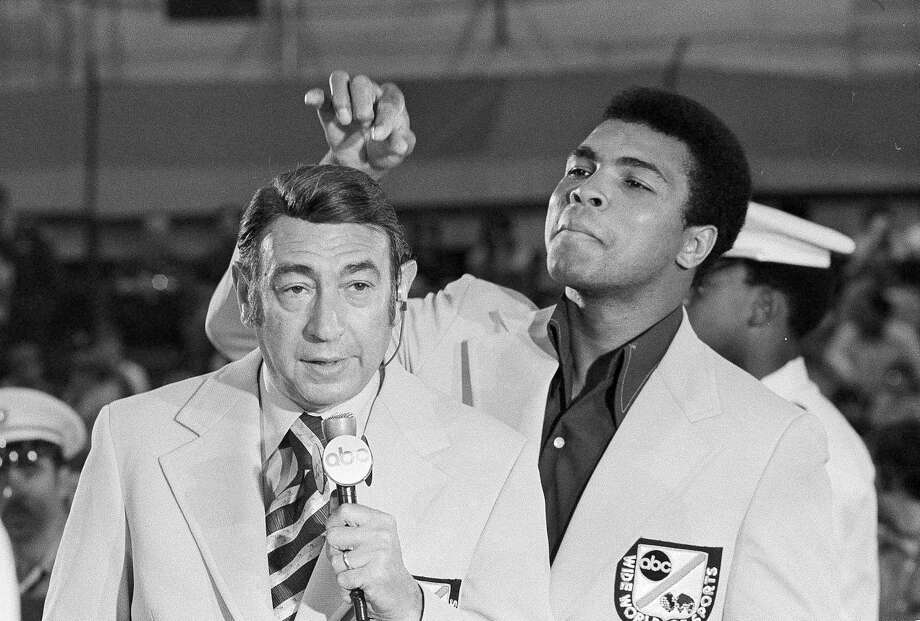 During his heyday, Howard Cosell chronicled the career of Muhammad Ali, seen here in a lighter moment with the iconic sportscaster during the 1972 Olympic boxing trials. Photo: Associated Press, STF / 1972 AP