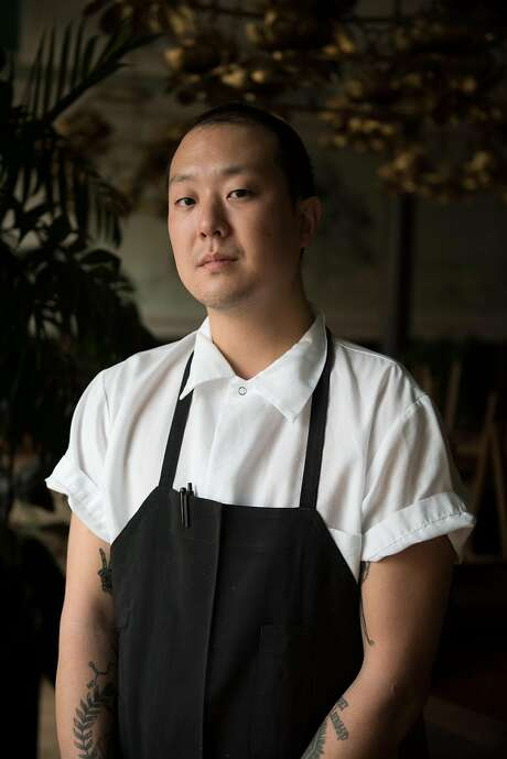 Eric Ehler stands for a portrait at Mister Jiu's in San Francisco, on Wednesday, March 21, 2018. The 29-year-old cook made a full recovery after suffering a heart attack at work. Photo: Rosa Furneaux, Special To The Chronicle