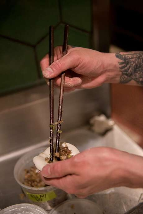 Eric Ehler stuffs dumplings at the end of his shift at Mister Jiu's. Photo: Rosa Furneaux, Special To The Chronicle