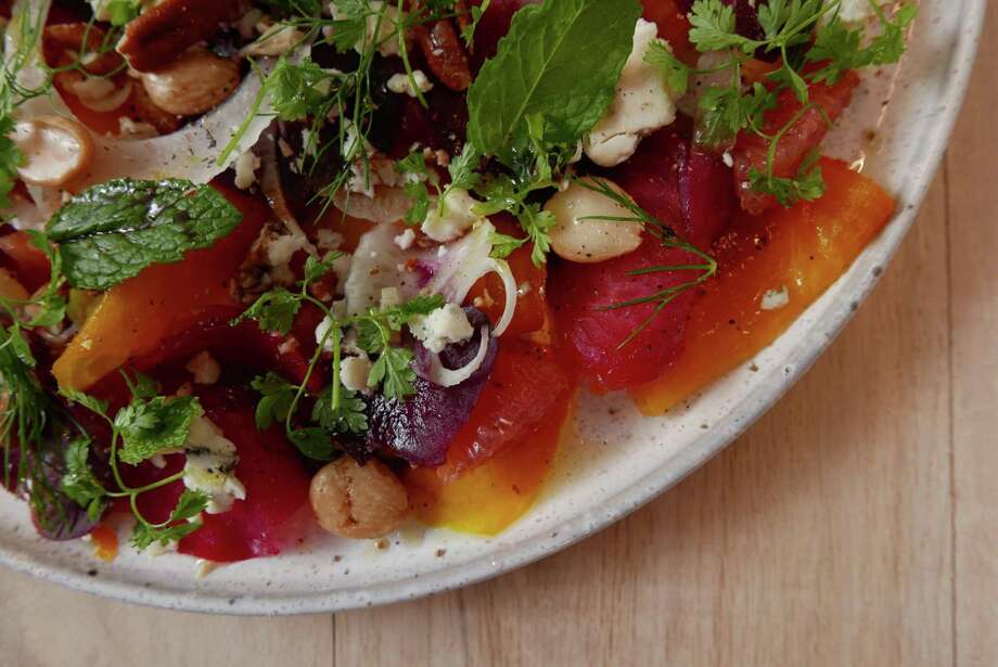 Ms. Julie's Beets from Clementine combines chioggia, golden other kinds of beets with Gorgonzola and herbs. Photo: Billy Calzada /San Antonio Express-News / San Antonio Express-News