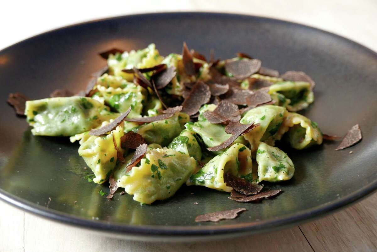 Handmade agnolotti pasta with spinach and mascarpone cheese, finished with shaved truffles at Clementine.