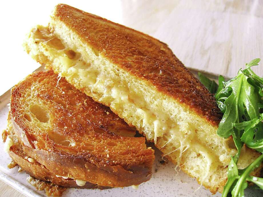 Kida's Grilled Cheese on sourdough with white cheddar and Barely Buzzed cheese and a side salad from the lunch menu at Clementine. Photo: Mike Sutter /San Antonio Express-News