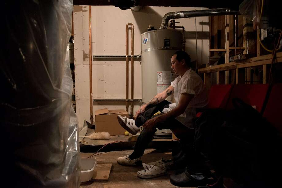 Eric Ehler puts his shoes on at the end of his shift at Mr Jiu�s in San Francisco on March 21, 2018. He finished his fourteen-hour shift at 1.15 AM. Photo: Rosa Furneaux, Special To The Chronicle